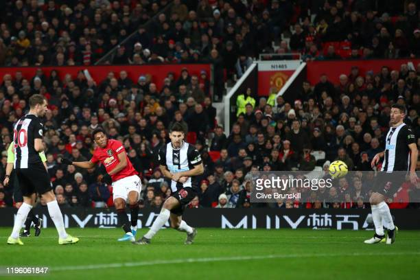 Anthony Martial of Manchester United scores his team's first goal during the Premier League match between Manchester United and Newcastle United at...