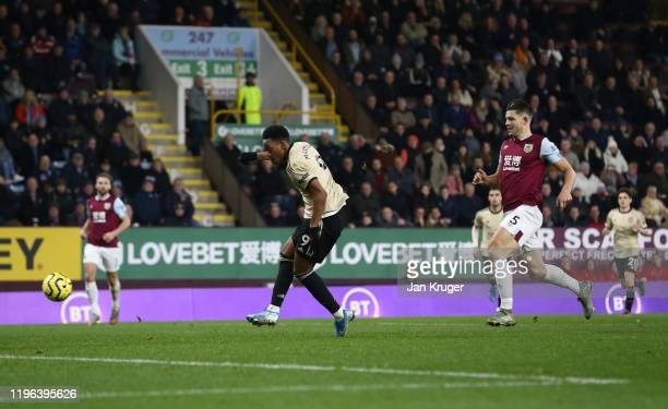 Anthony Martial of Manchester United scores his teams first goal during the Premier League match between Burnley FC and Manchester United at Turf...