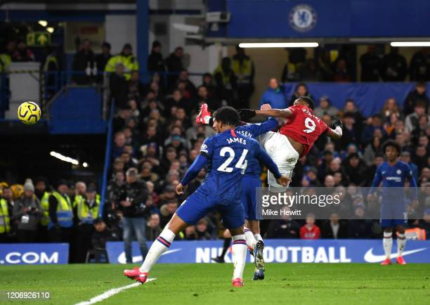 Anthony Martial of Manchester United scores his team's first goal during the Premier League match between Chelsea FC and Manchester United at...