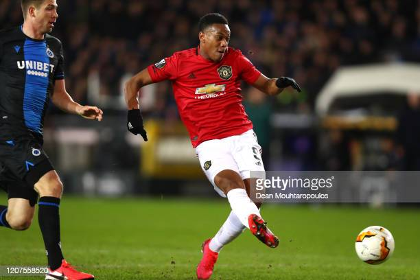 Anthony Martial of Manchester United scores his team's first goal during the UEFA Europa League round of 32 first leg match between Club Brugge and...