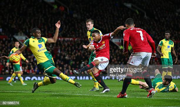 Anthony Martial of Manchester United scores his team's first goal during the Barclays Premier League match between Manchester United and Norwich City...