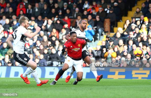 Anthony Martial of Manchester United scores his team's second goal during the Premier League match between Fulham FC and Manchester United at Craven...