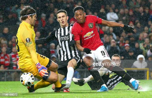 Anthony Martial of Manchester United scores his team's second goal during the UEFA Europa League group L match between Manchester United and Partizan...