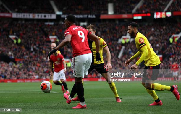 Anthony Martial of Manchester United scores his team's second goal during the Premier League match between Manchester United and Watford FC at Old...