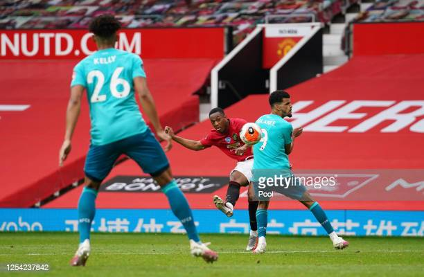 Anthony Martial of Manchester United scores his team's third goal past Dominic Solanke of AFC Bournemouth during the Premier League match between...