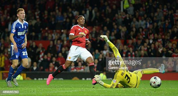 Anthony Martial of Manchester United scores his team's third goal past Bartosz Bialkowski of Ipswich Town during the Capital One Cup Third Round...