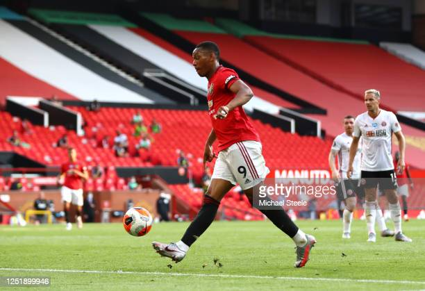 Anthony Martial of Manchester United scores his teams third goal during the Premier League match between Manchester United and Sheffield United at...