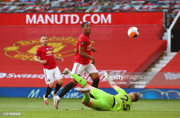 Anthony Martial of Manchester United scores his third goal past Dean Henderson of Sheffield United during the Premier League match between Manchester...