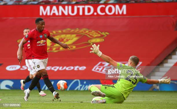 Anthony Martial of Manchester United scores his third goal past Simon Moore of Sheffield United during the Premier League match between Manchester...