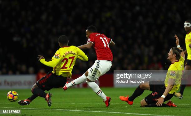 Anthony Martial of Manchester United scores the 3rd goal past Christian Kabasele of Watford during the Premier League match between Watford and...