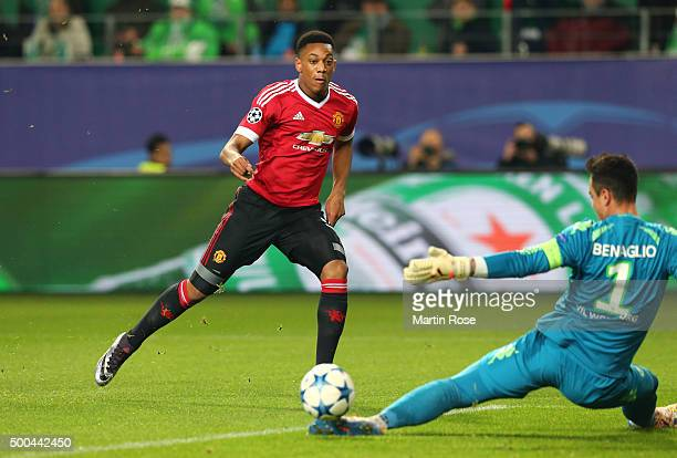 Anthony Martial of Manchester United scores the opening goal past Diego Benaglio of Wolfsburg during the UEFA Champions League group B match between...