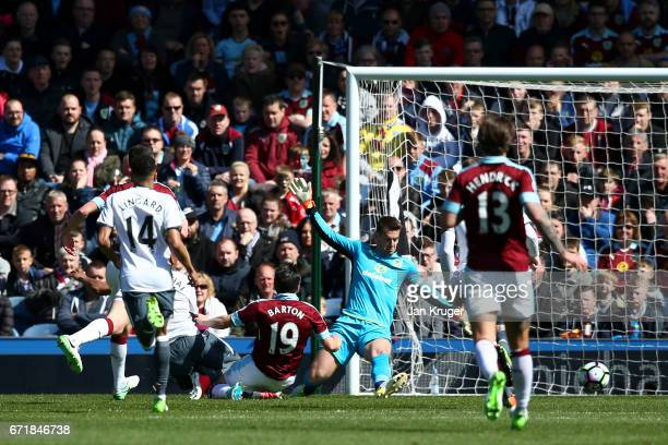 Anthony Martial of Manchester United scores the opening goal past Thomas Heaton of Burnley during the Premier League match between Burnley and...