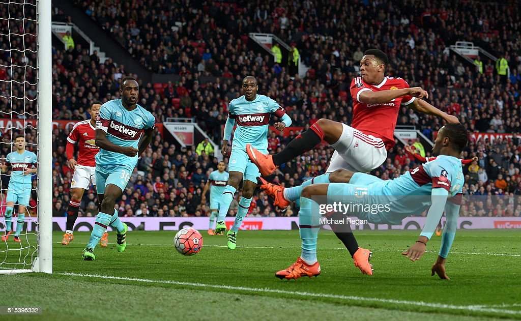 Anthony Martial of Manchester United (2R) scores their first and equalising goal during the Emirates FA Cup sixth round match between Manchester United and West Ham United at Old Trafford on March 13, 2016 in Manchester, England.