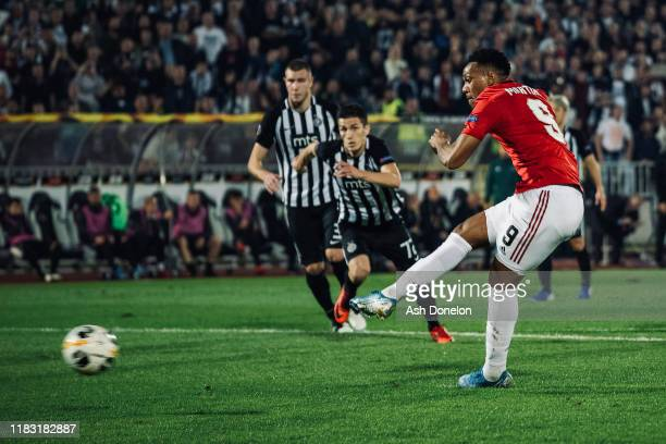 Anthony Martial of Manchester United scores their first goal during the UEFA Europa League group L match between Partizan and Manchester United at...