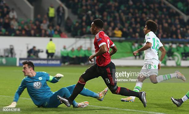 Anthony Martial of Manchester United scores their first goal during the UEFA Champions League match between VfL Wolfsburg and Manchester United at...