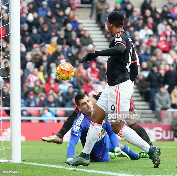 Anthony Martial of Manchester United scores their first goal during the Barclays Premier League match between Sunderland and Manchester United at...