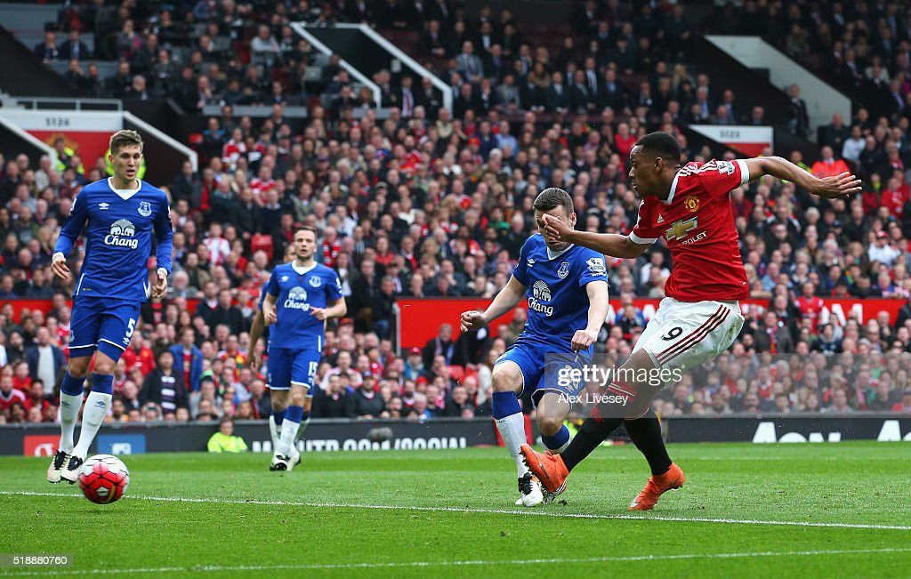 Anthony Martial of Manchester United (9) scores their first goal during the Barclays Premier League match between Manchester United and Everton at Old Trafford on April 3, 2016 in Manchester, England.