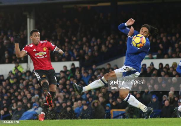 Anthony Martial of Manchester United scores their first goal during the Premier League match between Everton and Manchester United at Goodison Park...