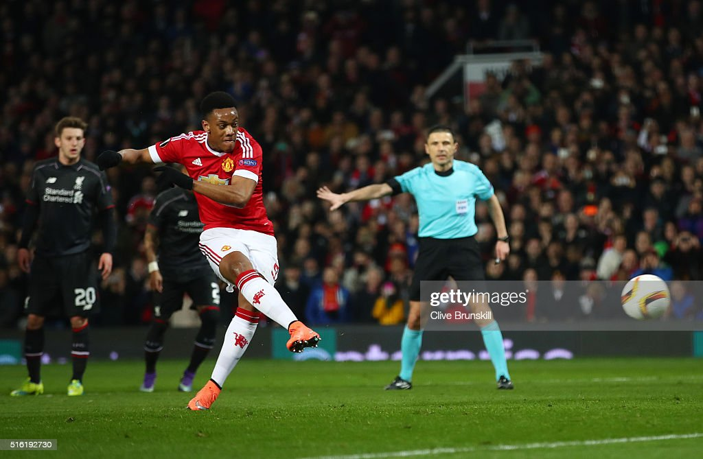 Anthony Martial of Manchester United scores their first goal from the penalty spot during the UEFA Europa League round of 16, second leg match between Manchester United and Liverpool at Old Trafford on March 17, 2016 in Manchester, England.