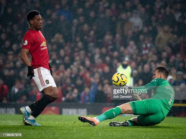 Anthony Martial of Manchester United scores their fourth goal during the Premier League match between Manchester United and Newcastle United at Old...
