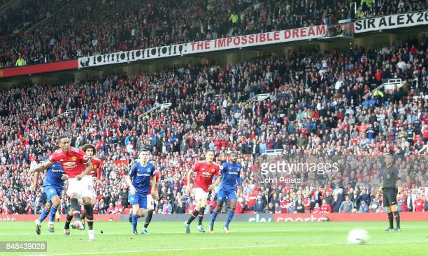 Anthony Martial of Manchester United scores their fourth goal during the Premier League match between Manchester United and Everton at Old Trafford...