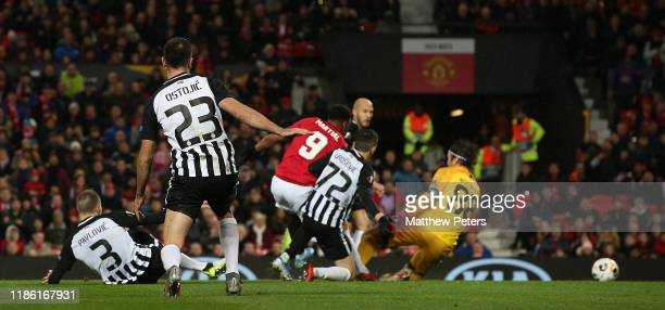 Anthony Martial of Manchester United scores their second goal during the UEFA Europa League group L match between Manchester United and Partizan at...