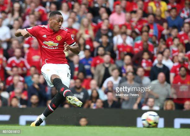 Anthony Martial of Manchester United scores their third goal during the Premier League match between Manchester United and West Ham United at Old...