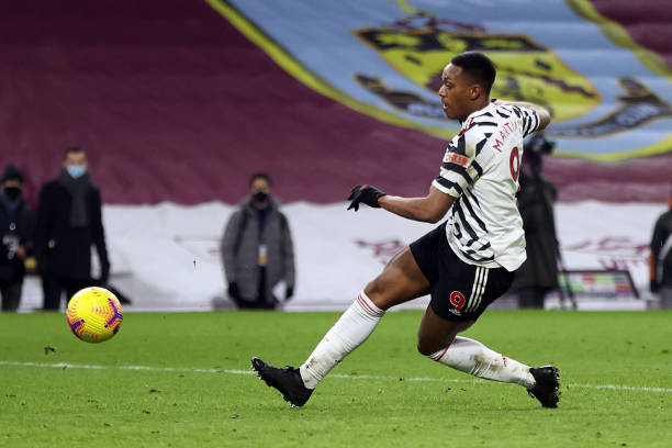 Anthony Martial of Manchester United shoots during the Premier League match between Burnley and Manchester United at Turf Moor on January 12, 2021 in...