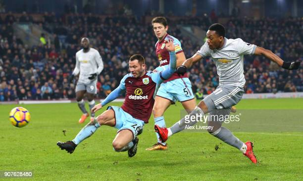 Anthony Martial of Manchester United shoots while under pressure from Phil Bardsley of Burnley during the Premier League match between Burnley and...