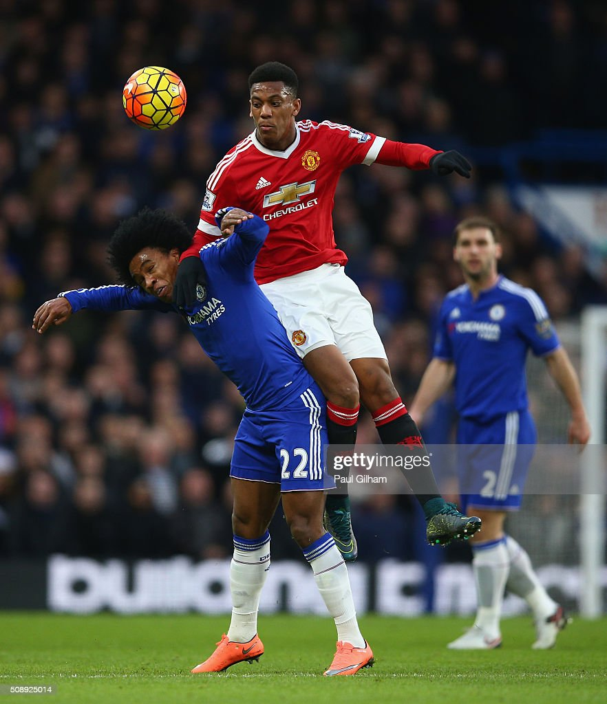 Anthony Martial of Manchester United tackles Willian of Chelsea during the Barclays Premier League match between Chelsea and Manchester United at Stamford Bridge on February 7, 2016 in London, England.