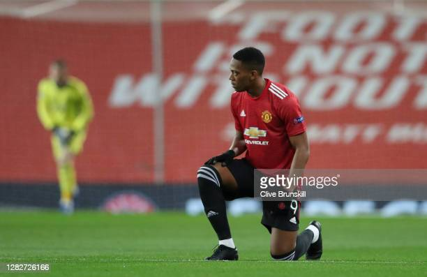 Anthony Martial of Manchester United takes a knee in support of the Black Lives Matter movement prior to the UEFA Champions League Group H stage...