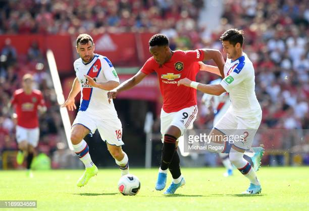 Anthony Martial of Manchester United takes on James McArthur and Joel Ward of Crystal Palace during the Premier League match between Manchester...
