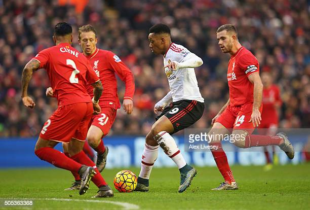 Anthony Martial of Manchester United takes on the Liverpool defence during the Barclays Premier League match between Liverpool and Manchester United...