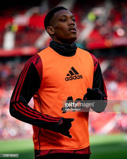 Anthony Martial of Manchester United warms up ahead of the Premier League match between Manchester United and Watford FC at Old Trafford on February...