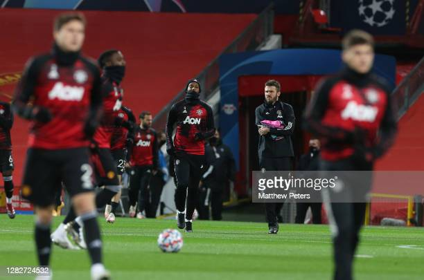 Anthony Martial of Manchester United warms up ahead of the UEFA Champions League Group H stage match between Manchester United and RB Leipzig at Old...