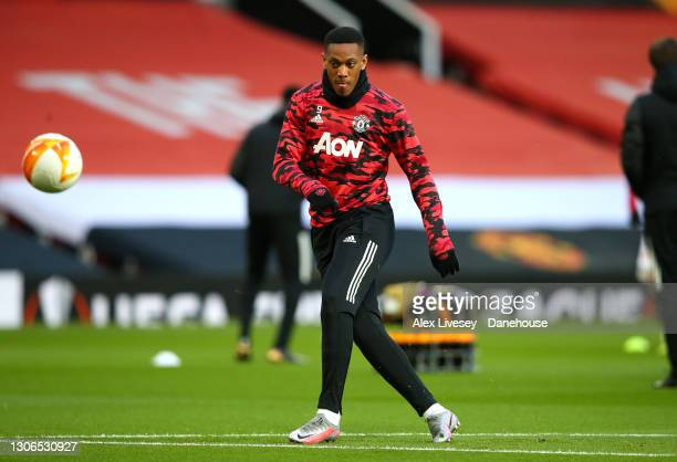 Anthony Martial of Manchester United warms up ahead of the UEFA Europa League Round of 16 First Leg match between Manchester United and A.C. Milan at...