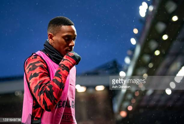 Anthony Martial of Manchester United warms up prior to the UEFA Europa League Round of 16 First Leg match between Manchester United and A.C. Milan at...