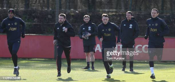 Anthony Martial Phil Jones and Nemanja Matic of Manchester United in action during a first team training session at Aon Training Complex on February...