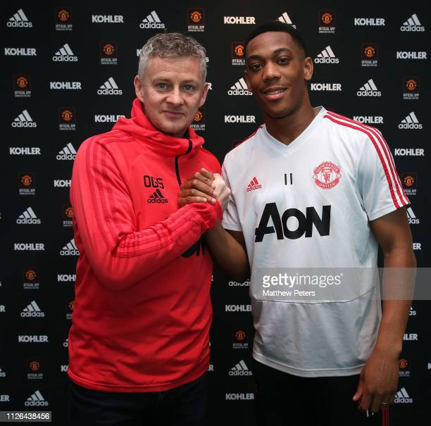 Anthony Martial poses with Caretaker Manager Ole Gunnar Solskjaer after signing an extension to his contract at Aon Training Complex on January 31...