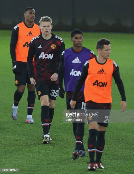 Anthony Martial Scott McTominay Marcus Rashford and Ander Herrera of Manchester United warm up ahead of the Carabao Cup Fourth Round match between...