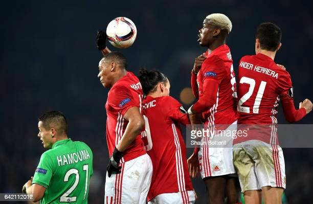 Anthony Martial Zlatan Ibrahimovic Paul Pogba and Ander Herrera of Manchester United react to a cross during the UEFA Europa League Round of 32 first...