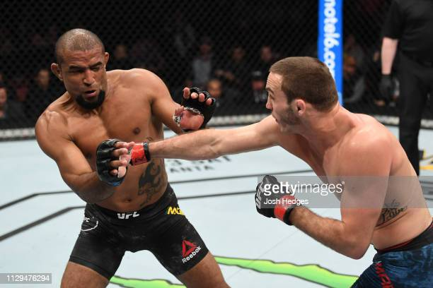 Anthony Martin punches Sergio Moraes of Brazil in their welterweight bout during the UFC Fight Night event at Intrust Bank Arena on March 9 2019 in...
