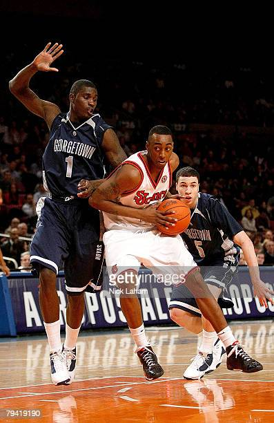 Anthony Mason, Jr. #2 of the St John's Red Storm drives against Vernon Macklin of the Georgetown Hoyas at Madison Square Garden on January 30, 2008...