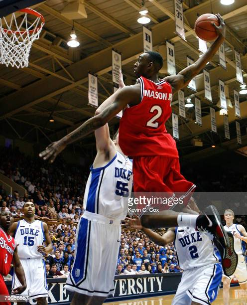 Anthony Mason Jr. #2 of the St. John's Red Storm dunks against Brian Zoubek and Nolan Smith of the Duke Blue Devils during the first half at Cameron...
