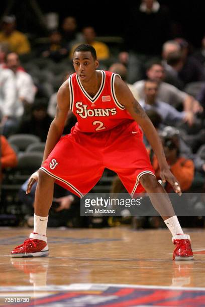 Anthony Mason Jr. #2 of the St. Johns Red Storm plays defense against the Marquette Golden Eagles during the first round of the Big East Championship...