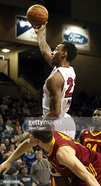 Anthony Mason Jr. #22 from the Sioux Falls Skyforce lays the ball up past Aleksander Czyz from the Canton Charge during NBA D-League game three,...