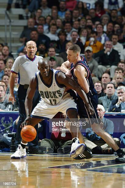 Anthony Mason of the Milwaukee Bucks drives against Aaron Williams of the New Jersey Nets in Game six of the Eastern Conference Quarterfinals during...