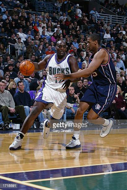 Anthony Mason of the Milwaukee Bucks is defended by Jason Collins of the New Jersey Nets during the game at Bradley Center on December 28 2002 in...