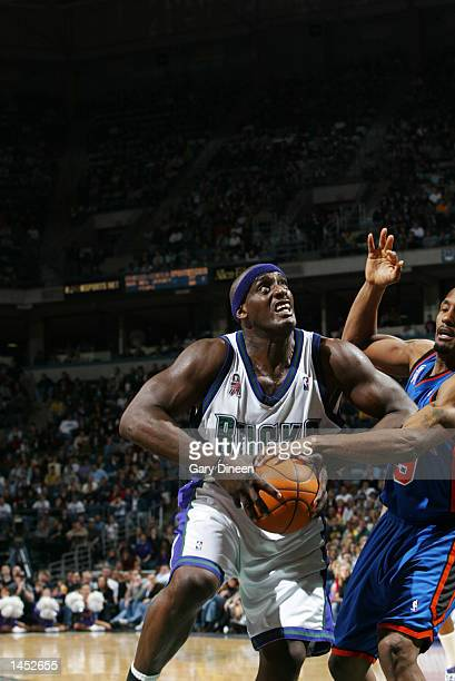 Anthony Mason of the Milwaukee Bucks looks to shoot against Shandon Anderson of the New York Knicks during the second overtime period of a NBA game...