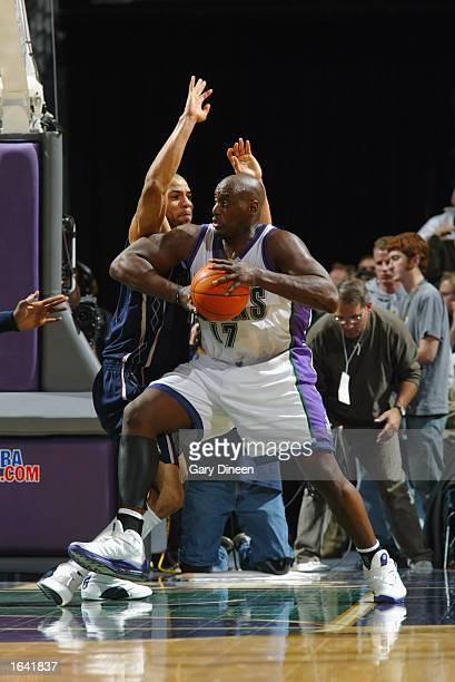Anthony Mason of the Milwaukee Bucks posts up Kenyon Martin of the New Jersey Nets during the NBA game at the Bradley Center on November 6 2002 in...
